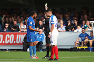 AFC Wimbledon midfielder Tom Soares (19) yellow card during the EFL Sky Bet League 1 match between AFC Wimbledon and Portsmouth at the Cherry Red Records Stadium, Kingston, England on 13 October 2018.