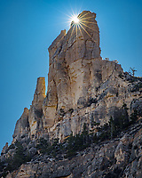 The Pryor Mountains of south central Montana are filled with many towering pinnacles and spires like this one. Last week was my first time hiking in this rarely visited mountain range, going up a deep canyon to the unique Layout Creek Spring. A herd of 160 wild horses live in these mountains, but I didn't see any this time. To get the sun ray effect I went off trail until I found the perfect position to partially obscure the sun behind the pinnacle. Using a smaller aperture produced an 18-point sunstar.