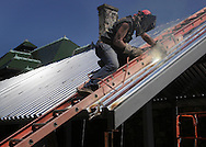Gary Scott of Ironworkers Local 417 works on the roof of a new biology classroom under construction at SUNY Orange in Middletown on Tuesday, July 26, 2011. Scott works for Gabriel Steel Erectors in Maybrook.