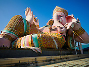 20 SEPTEMBER 2015 - SARIKA, NAKHON NAYOK, THAILAND:  The Ganesha statue at Shri Utthayan Ganesha Temple in Sarika, Nakhon Nayok. Ganesh Chaturthi, also known as Vinayaka Chaturthi, is a Hindu festival dedicated to Lord Ganesh. Ganesh is the patron of arts and sciences, the deity of intellect and wisdom -- identified by his elephant head. The holiday is celebrated for 10 days. Wat Utthaya Ganesh in Nakhon Nayok province, is a Buddhist temple that venerates Ganesh, who is popular with Thai Buddhists. The temple draws both Buddhists and Hindus and celebrates the Ganesh holiday a week ahead of most other places.    PHOTO BY JACK KURTZ