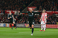 David Silva of Manchester city celebrates after he scores his teams 1st goal. Premier league match, Stoke City v Manchester City at the Bet365 Stadium in Stoke on Trent, Staffs on Monday 12th March 2018.<br /> pic by Andrew Orchard, Andrew Orchard sports photography.