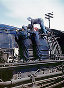 "Fascinating Color Portrait Photos of Women Railroad Workers During WWII<br /> <br /> World War II began when Hitler's army invaded Poland on September 1, 1939. However, it wasn't until the day after the Japanese attacked Pearl Harbor on December 7, 1941, that the United States declared war on the Axis Powers.<br /> <br /> The railroads immediately were called upon to transport troops and equipment heading overseas. Soon the efforts increased to supporting war efforts on two fronts-- in Europe and in the Pacific.<br /> <br /> Prior to the 1940s, the few women employed by the railroads were either advertising models, or were responsible primarily for cleaning and clerical work. Thanks to the war, the number of female railroad employees rose rapidly. By 1945, some 116,000 women were working on railroads. A report that appeared on the 1943 pages of Click Magazine regarding the large number of American women who had stepped forward to see to it that the American railroads continued to deliver the goods during the Second World War:<br /> <br />     ""Nearly 100,000 women, from messengers aged 16 to seasoned railroaders of 55 to 65, are keeping America's wartime trains rolling. So well do they handle their jobs that the railroad companies, once opposed to hiring any women, are adding others as fast as they can get them...""<br /> <br /> In April 1943, Office of War Information photographer Jack Delano photographed the women of the Chicago & North Western Railroad roundhouse in Clinton, Iowa, as they kept the hulking engines cleaned, lubricated and ready to support the war effort.<br /> <br /> Photo shows: Wipers clean an H-class locomotive.<br /> ©Library of Congress/Exclusivepix Media"