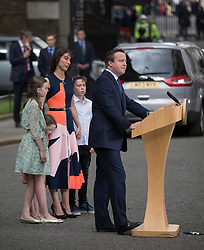 © Licensed to London News Pictures. 13/07/2016. London, UK. Prime Minister David Cameron's wife Samantha stands with their children (L-R) Nancy, Florence and Arthur as Mr Cameron speaks to reporters as he leaves Downing Street for the last time.  Photo credit: Peter Macdiarmid/LNP