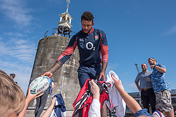 © Licensed to London News Pictures. 13/08/2019; Bristol, UK. Members of the England Rugby team meet fans after being introduced by host Vernon Kay at the Wear the Rose Live event at the Lloyds Amphitheatre on Bristol Harbourside. England's 31-man squad for the Rugby World Cup in Japan are attending the event in Bristol on Tuesday. The free-of-charge Wear the Rose Live from England sponsor O2 will see the full squad and coaches and special guest Jonny Wilkinson spend an afternoon in Lloyds Amphitheatre. The event features live music alongside a variety of carnival stalls and rugby games, manned by the players, with a chance for fans to win prizes. Photo credit: Simon Chapman/LNP.