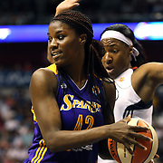 Jantel Lavender, (left), Los Angeles Sparks, in action during the Connecticut Sun Vs Los Angeles Sparks WNBA regular season game at Mohegan Sun Arena, Uncasville, Connecticut, USA. 3rd July 2014. Photo Tim Clayton