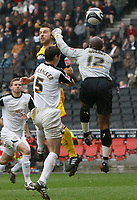 Photo: Steve Bond/Richard Lane Photography. MK Dons v Southampton. Coca-Cola Football League One. 20/03/2010. Rickie Lambert (L) scores above the despairing punch of keeper Willy Gueret