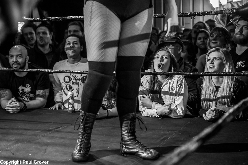"""Photo Dispatch.Pic Shows Wrestling fans watching Women Wrestlers performing at the EVE event at the Resistance Gallery in Bethnal Green Eve was originally developed in 2010 by married couple Dann and Emily Read due to their desire to showcase women's professional wrestling.[1][2] They also wanted to provide positive female role models for their daughter.[1][3] Emily describes the promotion as a """"feminist, grassroots promotion,"""" as well as punk.[1] In 2012, Pro-Wrestling: EVE was included in Vice magazine's documentary The British Wrestler,[4] as well as a feature in Fabulous magazine.[5]<br /> In 2017, both women's wrestling and British professional wrestling in general enjoyed a growth in popularity internationally.[1] The promotion broadcasts shows on internet pay-per-view (iPPV).[6]<br /> <br /> The Pro-Wrestling: EVE Championship is a women's professional wrestlingchampionship. Championship reigns are determined by professional wrestling matches, in which competitors are involved in scripted rivalries. These narratives create feuds between the various competitors, which cast them as villains and heroines."""