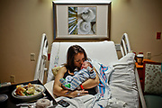William DeShazer/Staff<br /> Rachel Marais, of Naples, kisses her newborn son, Levi, at The NCH Healthcare System on Tuesday Jan 1, 2013. Levi Charles Marais was born at 12:35am and weighs eight pounds two ounces.