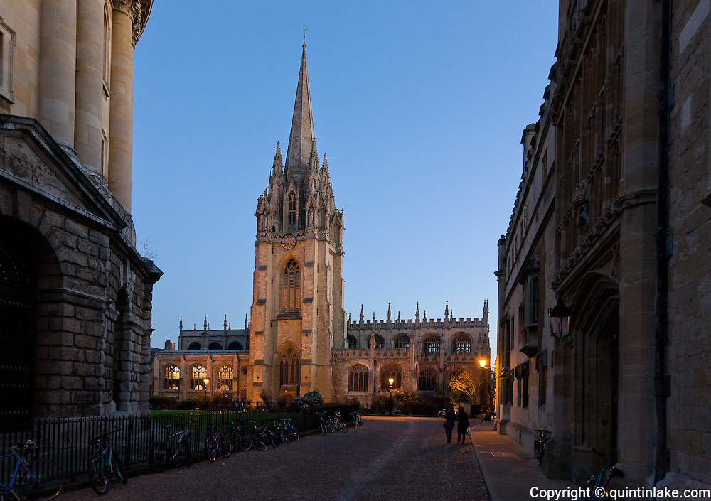 Tower of University Church of St Mary the Virgin, Oxford seen from Radcliffe Square at dusk. Built in the 13th century. The architect is unknown, though the master mason in 1275 was Richard of Abingdon.