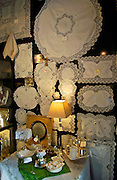 Display of white linen in draper's shop in Kloskanthuis, Ghent, Belgium