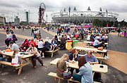London 2012 Olympic Park in Stratford, East London. One of the many eating / food areas around the site. People can come and take time off their feet on the picnic benches.