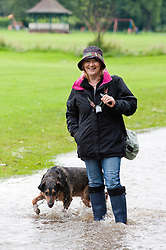 While the threatened floods around Sheffield were of concern to some for others like Aileen Brawley and Wallace the dog of Ecclesfield it was a chance to get out and have some fun..6 July 2012.Image © Paul David Drabble