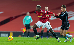 MANCHESTER, ENGLAND - Friday, January 1, 2020: Manchester United's Paul Pogba (L) and Aston Villa's Matthew Cash during the New Year's Day FA Premier League match between Manchester United FC and Aston Villa FC at Old Trafford. The game was played behind closed doors due to the UK government putting Greater Manchester in Tier 4: Stay at Home during the Coronavirus COVID-19 Pandemic. (Pic by David Rawcliffe/Propaganda)