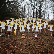 Twenty-seven wooden angel figures placed in a wooded area beside the road in Sandy Hook after the mass shootings at Sandy Hook Elementary School, Newtown, Connecticut, USA. 16th December 2012. Photo Tim Clayton