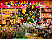 """19 FEBRUARY 2015 - BANGKOK, THAILAND: Chinese dragon dancers perform for Chinese New Year in a business on Yaowarat Road in Bangkok. 2015 is the Year of Goat in the Chinese zodiac. The Goat is the eighth sign in Chinese astrology and """"8"""" is considered to be a lucky number. It symbolizes wisdom, fortune and prosperity. Ethnic Chinese make up nearly 15% of the Thai population. Chinese New Year (also called Tet or Lunar New Year) is widely celebrated in Thailand, especially in urban areas that have large Chinese populations.    PHOTO BY JACK KURTZ"""