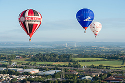© Licensed to London News Pictures. 29/07/2019; Bristol, UK. Balloons fly north from Bristol with the Second Severn Crossing in the background. Press preview event for the 41st Bristol International Balloon Fiesta 2019 which will take place from 08 - 11 August 2019. For the preview up to 25 hot air balloons will take off from Filton Airfield, next to the Brabazon Hangar which is the site of a proposed new YTL Arena, and Aerospace Bristol to play homage to the 50th anniversary of Concorde. The Bristol International Balloon Fiesta attracts hundreds of thousands of visitors and this year the Fiesta will be celebrating Icons of Bristol and look to highlight some of the things that make up the home of the International Balloon Fiesta. The event has joined forces with Aerospace Bristol to honour one of the city's most famed creations, Concorde and Aardman Animations who are celebrating the 30th anniversary of Wallace and Gromit. Over the course of four days, the Bristol International Balloon Fiesta will play host to more than 100 colourful hot air balloons of all sizes and shapes. Special shapes are an iconic part of the Fiesta and the event kicks off with its now traditional special shapes launch on Thursday evening of 08 August. Photo credit: Simon Chapman/LNP.