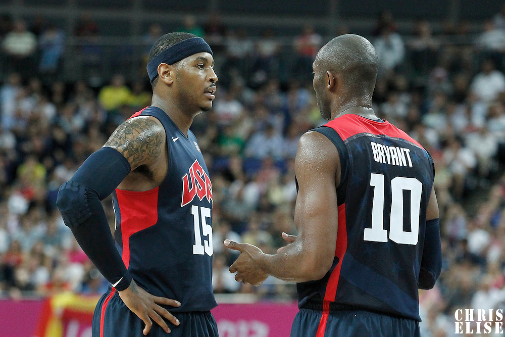 10 August 2012: USA Carmelo Anthony listens to Kobe Bryant during 109-80 Team USA victory over Team Argentina, during the men's basketball semi-finals, at the North Greenwich Arena, in London, Great Britain.