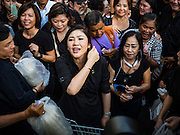 11 NOVEMBER 2016 - BANGKOK, THAILAND: YINGLUCK SHINAWATRA talks to supporters at a rice distribution sale in the Bangkok suburbs. Yingluck Shinawatra, the former Thai Prime Minister deposed in a coup in 2014, has started selling rice directly to Thai consumers. She buys the rice from farmers at market prices and then sells it to urban consumers at the price she paid. She said she's doing it to help out farmers, who are trying to deal with depressed prices. Yingluck is facing prosecution on corruption related charges going back to a rice price support scheme her government used to try to help farmers in 2011 and 2012. Even after the coup, she is still personally popular and hundreds of people showed up to see her at the rice distribution point at a mall in Samut Prakan province, in suburban Bangkok.   PHOTO BY JACK KURTZ