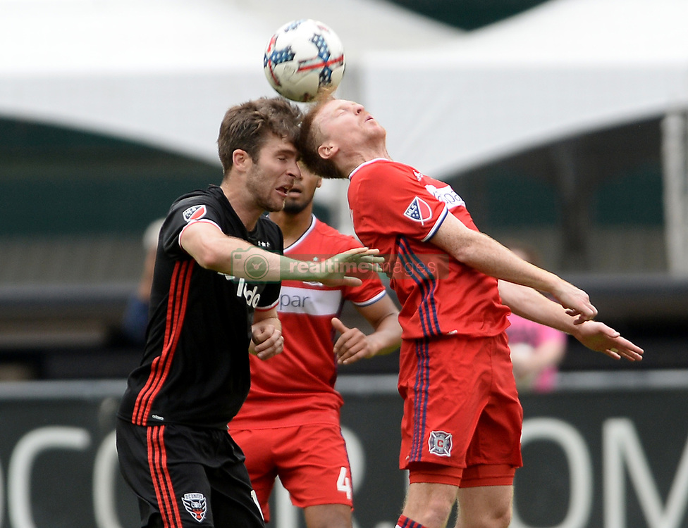 May 20, 2017 - Washington, DC, USA - 20170520 - Chicago Fire midfielder DAX MCCARTY (6), right, heads the ball against D.C. United forward PATRICK MULLINS (16) in the first half at RFK Stadium in Washington. (Credit Image: © Chuck Myers via ZUMA Wire)