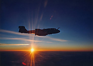 As the sun sets, a EA-6B Prowler flies over the Pacific.