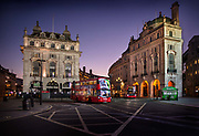 Piccadilly Circus, deserted at 7.30pm Saturday night during the Coronavirus pandemic on 4th April 2020 in London, United Kingdom. The government clampdown includes the closure of most shops, bars and theatres throughout the country.