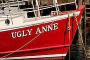 The bow of a fishing boat sits in the harbor of Maine's coastal town of Ogunquit.