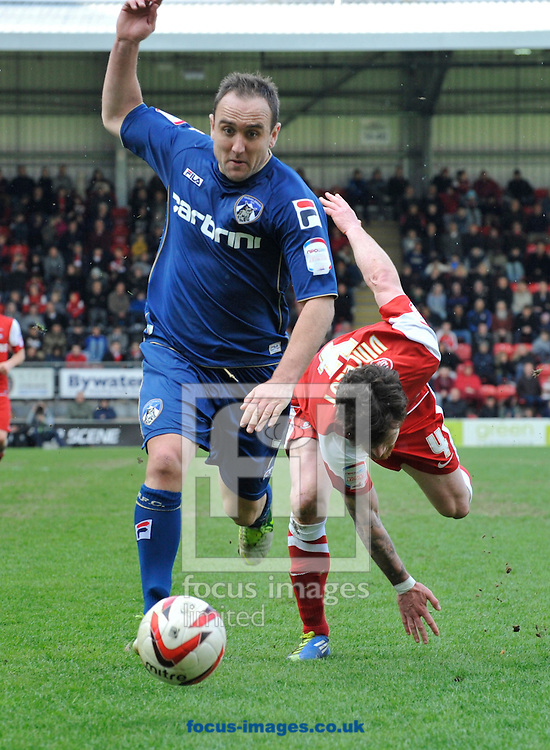 Picture by Alan Stanford/Focus Images Ltd +44 7915 056117.27/04/2013.Romain Vincelot of Leyton Orient looses the ball to Lee Croft of Oldham Athletic during the npower League 1 match at the Matchroom Stadium, London.. .