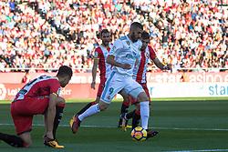 GIRONA, Oct. 30, 2017  Real Madrid's Karim Benzema (2nd R) dribbles during a Spanish league match between Real Madrid and Girona at Montilivi Stadium, Girona, Spain, on Oct. 29, 2017. Girona won 2-1. (Credit Image: © Joan Gosa/Xinhua via ZUMA Wire)