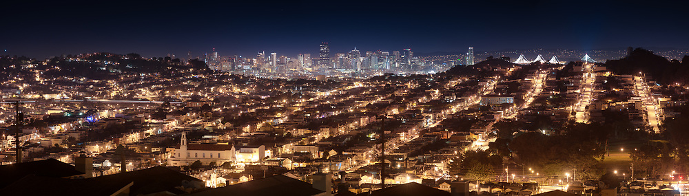 Bernal Heights, downtown San Francisco and the outer mission are seen from a neighborhood along the hills of San Bruno Mountain. Daly City, CA