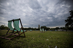 © Licensed to London News Pictures. 09/07/2021. Grey clouds hang over empty deckchairs in Hyde Park, central London. Wet and warm conditions are expected over the weekend. Photo credit: Ben Cawthra/LNP