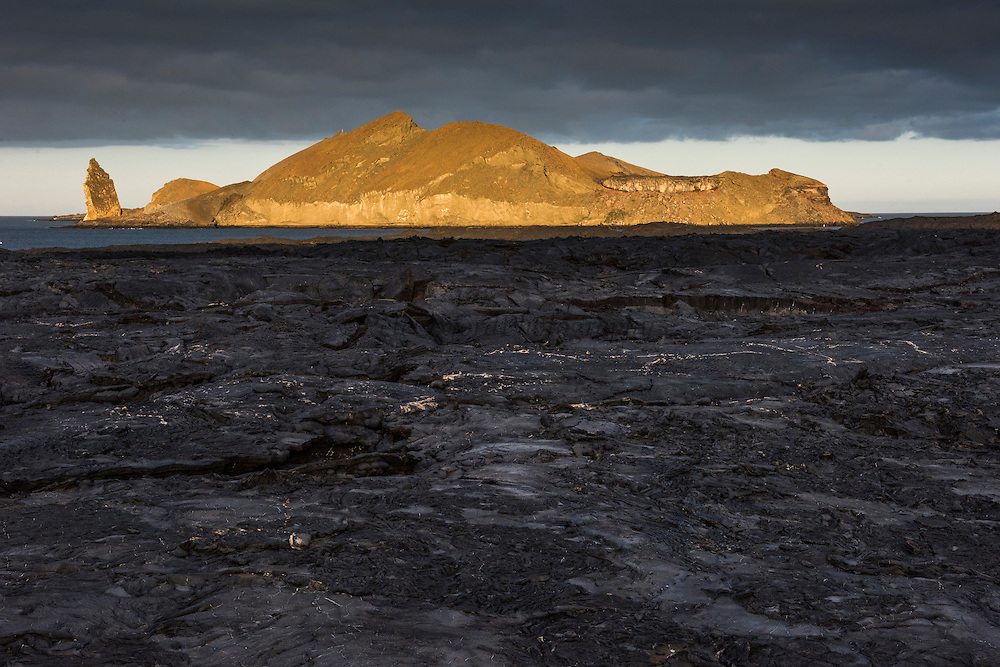 Lava on Sullivan Bay<br /> a recent (1897) pahoehoe lava flow<br /> Sullivan Bay <br /> Santiago <br /> Pinnacle Rock and Bartolome Island in back<br /> Galapagos<br /> Ecuador, South America