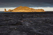 Lava on Sullivan Bay<br /> a recent (1897) pahoehoe lava flow<br /> Sullivan Bay <br /> Santiago <br /> Pinnacle Rock and Bartolome Island in back<br /> Galapagos<br /> Ecuador, South America