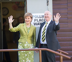 First Minister of Scotland and leader of the SNP Nicola Sturgeon, casts her vote with her husband Peter Murrell on May 7, 2015 in Glasgow, Scotland.
