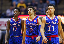 Jan 19, 2019; Morgantown, WV, USA; Kansas Jayhawks guard Quentin Grimes (5) walks with teammates after a timeout during the second half against the West Virginia Mountaineers at WVU Coliseum. Mandatory Credit: Ben Queen-USA TODAY Sports