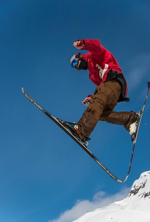 Alaska, Alyeska Resort, Chugach Mountains, freestyle skier doing Ski Jumping tricks.