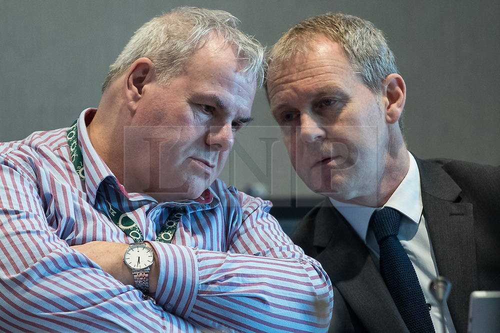 © Licensed to London News Pictures . 27/10/2017 . Manchester , UK . RICHARD FARNELL (left, consulting with a colleague) , leader of Rochdale City Council , at the Lowry Centre in Salford at a meeting of the Greater Manchester Combined Authority . Farnell has been accused of lying to an ongoing Child Sexual Abuse enquiry about a report in to sexual abuse by men , including MP Cyril Smith , at Knowl View School . Photo credit : Joel Goodman/LNP