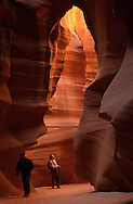 Visitors to Antelope Canyon enter one of two slot canyons illuminated by glowing light on the sandstone walls.  The slot canyons, on the Navajo reservation, are a popular site for their fascinating formations and attract many tourists, especially photographers, who come to the Page, Arizona area near Glen Canyon Dam and Lake Powell.  Wednesday, March 13, 2003.