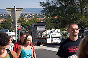 mass tourism walking from the bus to their tourist destination in South France