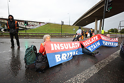 © Licensed to London News Pictures. 01/10/2021. London, UK. Climate protest group Insulate Britain attempt to block the M1 at the junction with the North Circular at Staples Corner in North London. Insulate Britain have successfully blocked various roads around the capital over a number of weeks, resulting in a court injunction banning them from going near the M25 motorway. Photo credit: Ben Cawthra/LNP