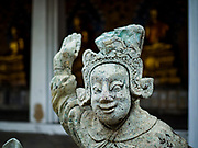 """11 SEPTEMBER 2017 - BANGKOK, THAILAND: Chinese statues that came to Siam in the 18th and 19th centuries as ballast in Chinese traders sailing ships in the courtyard at Wat Arun. Renovations are nearly finished at Wat Arun on the Thonburi side of the Chao Phraya River in Bangkok. Wat Arun is famous for its Khmer style main """"prang"""" (chedi). It was originally built in the Ayutthaya Period and rebuilt to its current form in the time of Rama II.      PHOTO BY JACK KURTZ"""