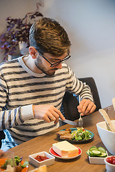 Man eating a cold meal with salad, Munich, Germany