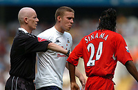 Picture: Henry Browne.Digitalsport<br /> Date: 14/08/2004.<br /> Tottenham Hotspur v Liverpool FA Barclays Premiership.<br /> <br /> Referee Dermot Gallagher seperates Spurs' Sean Davis and Liverpool's Florent Sinama - Pongolle.