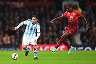 Carlos Tevez of Argentina and William Carvalho of Portugal - Argentina vs. Portugal - International Friendly - Old Trafford - Manchester - 18/11/2014 Pic Philip Oldham/Sportimage