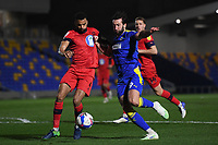 Football - 2020 / 2021 Sky Bet League One - AFC Wimbledon vs Wigan Athletic - Plough Lane<br /> <br /> AFC Wimbledon's Ollie Palmer battles for possession with Wigan Athletic's Curtis Tilt.<br /> <br /> COLORSPORT/ASHLEY WESTERN
