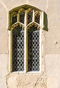 Village parish church of Saint Mary, Nettlestead, Suffolk, England, UK architectural detail old window