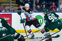 KELOWNA, BC - FEBRUARY 28: Jake Lee #21 of the Kelowna Rockets skates with the puck as Ty Kolle #90 of the Everett Silvertips moves in for the check during first period at Prospera Place on February 28, 2020 in Kelowna, Canada. (Photo by Marissa Baecker/Shoot the Breeze)