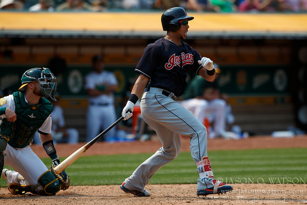 OAKLAND, CA - JULY 01: Michael Brantley #23 of the Cleveland Indians hits a two run single against the Oakland Athletics during the eighth inning at the Oakland Coliseum on July 1, 2018 in Oakland, California. The Cleveland Indians defeated the Oakland Athletics 15-3. (Photo by Jason O. Watson/Getty Images) *** Local Caption *** Michael Brantley