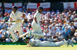 England's Dawid Malan and Jonny Bairstow pile on the runs as Australia's Cameron Bancroft looks on in the field during day one of the Ashes Test match at the WACA Ground, Perth.