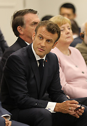"""Emmanuel Macron (French President), Jair Bolsonaro (Brazil's President), Angela Merkel (German Chancellor) - Side event organized by the Japanese Prime Minister, on the theme """"Promoting the place of women at work"""" at the Intex Osaka congress center at the G20 summit in Osaka, Japan, on June 29, 2019. Photo by Dominque Jacovides/Pool/ABACAPRESS.COM"""