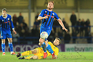 Callum Camps is challenged during the EFL Sky Bet League 1 match between Rochdale and Oxford United at Spotland, Rochdale, England on 12 March 2019.
